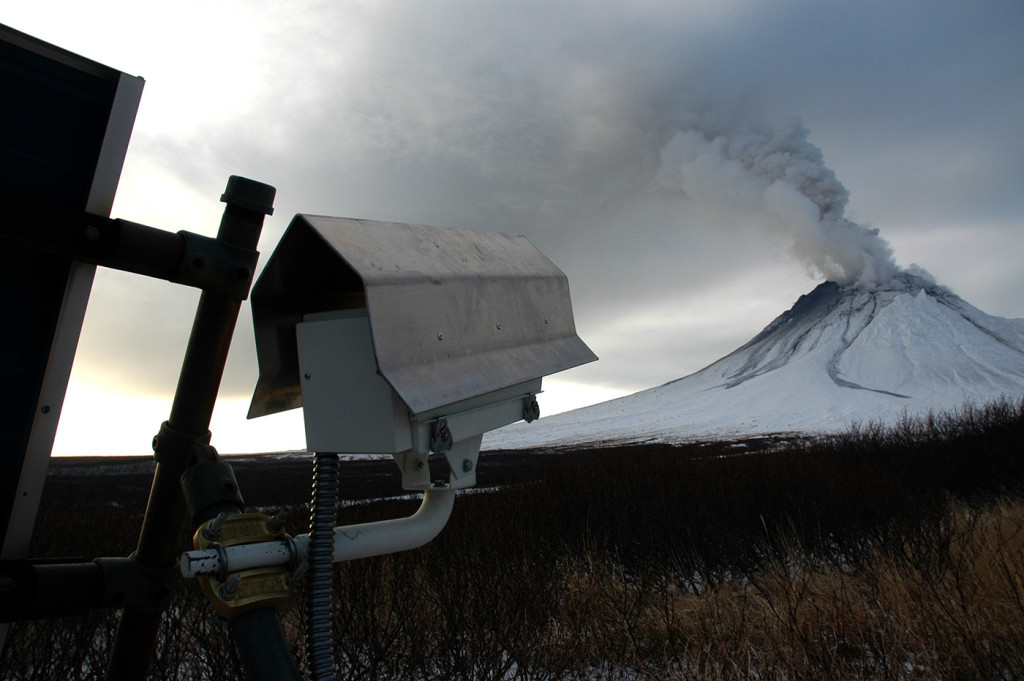 Mound camera focused on Mount Augustine. The camera's housing has a protective debris- and snow-shedding shield of bent aluminum. The housing is mounted to an Alaska Volcano Observatory solar-panel structure. Taken January12, 2006 / Courtesy USGS Michelle Combs