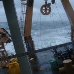 View from the aft conning station during a roll of the ship. Note the horizon relative to the deck of the ship.  The aft conning station is from where the winches are operated and has wonderful window views.