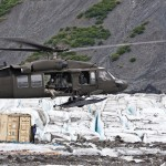 Photo courtesy of US Army Staff Sgt. Brehl Garza / A UH-60 Blackhawk helicopter from the Alaska Army National Guard prepares to drop off members of the 3rd Aircraft Maintenance Squadron's Crash Recover team on Colony Glacier, Alaska on July 10, 2012.