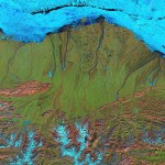 Alaska's North Slope in false-color. Bright blues are ice, greens denote vegetation cover, pink is open rockface. / Photo courtesy NASA Earth Observatory
