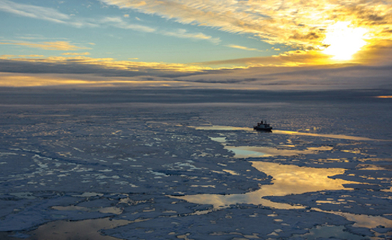 Polarstern in the Central Arctic (position approx. 83° N, 130° O). One-year thin sea ice predominated in the Arctic in the summer of 2012. The ice cover is permeated by open water areas and melting ponds. / Courtesy: Stefan Hendricks, Alfred Wegener Institute