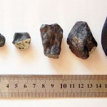 Fragments of meteorite which flew over the Chelyabinsk region, Russia on February 15, 2013. Parts found in Yetkulsky district of Chelyabinsk region by an expedition of Chelyabinsk State University. / By Alexander Sapozhnikov (Creative Commons Attribution-Share Alike 3.0 Unported license)