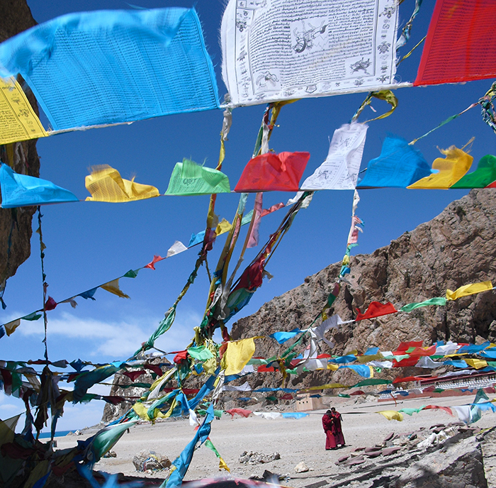 monks prayer flags Tibet