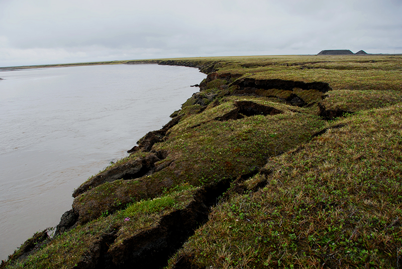 Soil collapses as a result of permafrost thaw and erosion in this image taken along the Sagavanirktok River on the North Slope of Alaska near Deadhorse. / Courtesy National Snow and Ice Data Center & CIRES