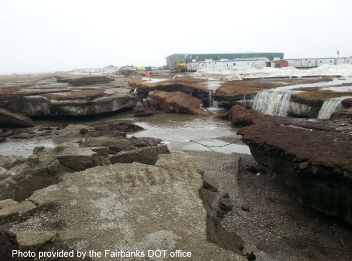 A stretch of the Dalton Highway broken apart due to destabilized permafrost and water. Discussed by Vladimir Romanovsky in permafrost presentation. Photo provided by the Fairbanks DOT office.