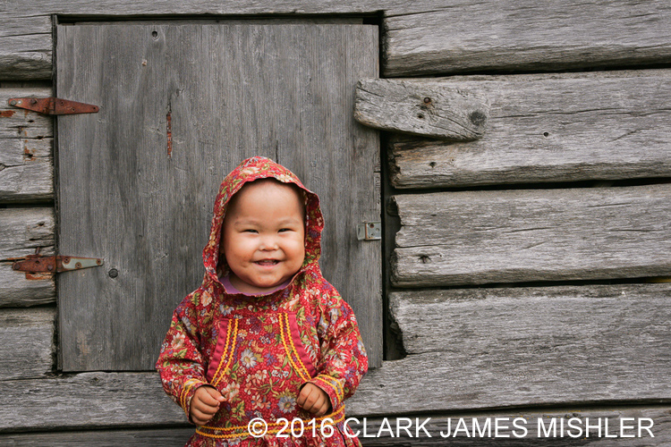 Young Yup'ik girl, Shaylene Spein, in traditional kuspuk, Kwethluk, Alaska / Photo by Clark James Mishler
